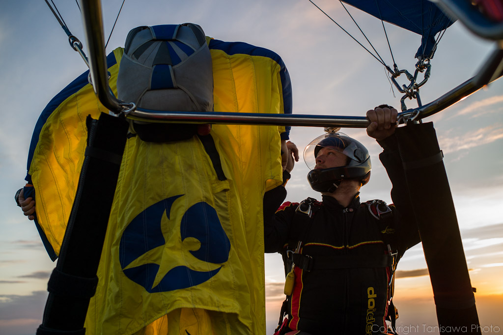Preparing to jump with wingsuite from balloon.